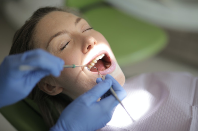 dentist working on a rotten tooth