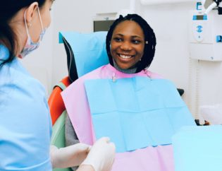 a woman getting a dental checkup