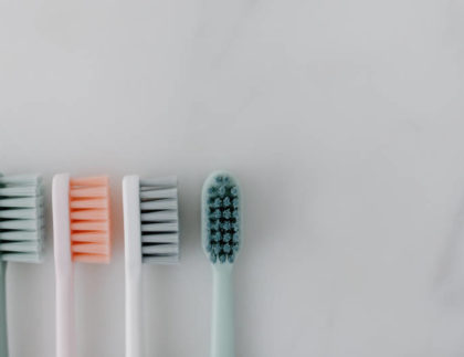 a collection of toothbrushes on a table
