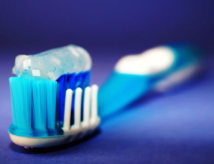 picture of a toothbrush with toothpaste on it